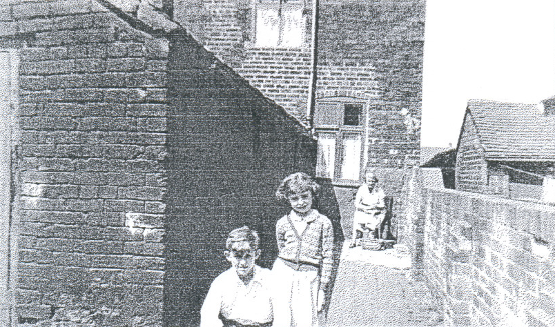 In a neighbour s yard in the bach. Mrs Moran peeled potatoes at the top of the yard while her son Andy took a photograph of myself and one of my brothers.