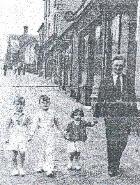 August 1950. Walkingdown Smallthorne bank with my brothers and myfather.